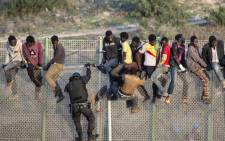 About 14 African migrants were injured while crossing into Europe. Picture: AFP.