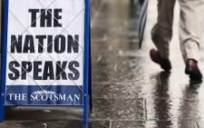A Scottish newspaper advertising billboard is pictured in Edinburgh, Scotland, on 19 September, 2014, following a pro-union victory in the referendum on Scottish independence. Picture: AFP.