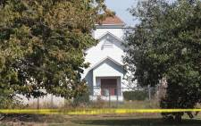 Crime scene tape remains stretched along a road near the First Baptist Church of Sutherland Springs on 7 November 2017 in Sutherland Springs, Texas. Picture: AFP