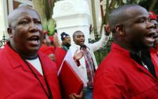 Economic Freedom Fighters leader Julius Malema is seen leaving Parliament in Cape Town on Thursday, 21 August 2014 with EFF MPs. Picture: Sapa.