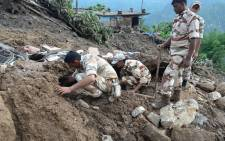This handout photograph released on July 2, 2016 by the Indian Army shows Indian soldiers searching for survivors of a landslide following torrential rains in the Pithoragarh area of rural Uttarakhand state. The death toll from landslides and flooding in northern India has risen to 25 after rescuers found more bodies buried under debris, officials said on July 2. At least dozens more are missing after torrential rains triggered landslides and floods in the Himalayan states of Uttarakhand and Arunachal Pradesh. Picture: INDIAN ARMY/AFP.