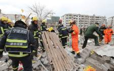 Rescue workers search at the site of an explosion in Ningbo, China's eastern Zhejiang province on 26 November 2017. Picture: AFP.