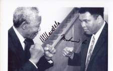 A black and white signed photograph of former President Nelson Mandela with Mohammed Ali was one of the items sold at the auction. Picture: Supplied.