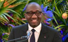 Ivorian Trade minister Souleymane Diarrassouba delivers a speech during the inauguration of a shopping mall Playce Palmeraie in Abidjan on 29 June 2017. Picture: AFP