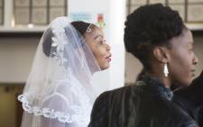 A bride waits to say 'I do' during the mass wedding ceremony at Robben Island on Valentine's Day. Picture: Cindy Archillies/EWN