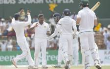 Sri Lanka players celebrate the fall of a South African wicket during day four of the second Test in Colombo on 23 July 2018. Picture: @OfficialCSA/Twitter
