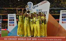 FILE: Australia's teammates raise the trophy as they celebrate victory against New Zealand after their 2015 Cricket World Cup final in Melbourne on March 29, 2015.  Picture: AFP