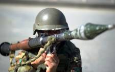 An Afghan soldier carries a rocket-propelled grenade and launcher. Picture: AFP.