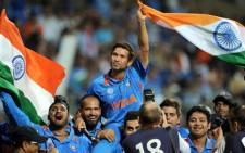 Indian batsman Sachin Tendulkar is carried onto the field by his teammates. Picture: AFP.