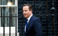 British Prime Minister David Cameron leaves 10 Downing Street in central London after a Cabinet meeting to discuss a response to Syria following chemical attacks that Britain believe were launched by the Syrian regime. 29 August 2013. Picture: Leon Neal/AFP