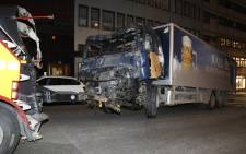 FILE: The stolen truck, which was driven through a crowd outside a department in Stockholm on 7 April, 2017, is taken away on 8 April. Picture: AFP.