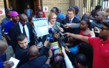 DA leader Helen Zille stands outside the North Gauteng High Court in Pretoria with the so-called Zuma spy tapes on 4 September 2014. Picture: Vumani Mkhize/EWN.
