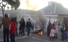 FILE: Residents of Zwelihle mobilise on 17 May 2018 as they protest for land and housing in Hermanus. Picture: @REDANTS_CT/Twitter