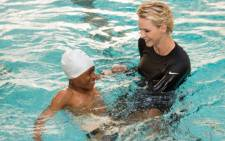 Princess Charlene of Monaco teaching South African children to swim as part of the South Africa-Monaco Rugby Exchange. Picture: Gaetan Luci/Palais Princier.