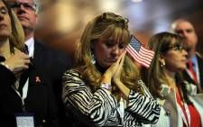 Supporters of Republican presidential candidate Mitt Romney react to results on election night November 6, 2012 in Boston Massachusetts. US President Barack Obama was re-elected Tuesday, November 6, 2012, television networks projected -- only the second time in several decades that a Democrat has won a second term in the White House.Picture: AFP.