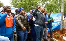 Democratic Alliance leader Mmusi Maimane outside the Gupta compound in Saxonworld, Johannesburg. Picture: EWN.