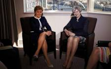 Britain's Prime Minister Theresa May (R) and Scotland's First Minister Nicola Sturgeon pose for a photograph ahead of their meeting in a hotle in Glasgow, on March 27, 2017. British Prime Minister Theresa May travelled to Scotland on Monday to try to avert its independence bid while also fighting a political crisis in Northern Ireland in the frantic final days before she launches Brexit. Picture: AFP.
