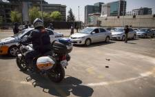 Police escort Ubers, metered and minibus taxis from the Sandton Central area to the impound lot after drivers failed to produce permits 15 September 2017. Picture: Thomas Holder/EWN