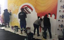 Young people in Daveyton on the East Rand are spreading their message for World Aids Day through art at the Sinaba Stadium. Picture: Masego Rahlaga/EWN.