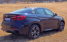 BMW X6 wide rear side view of slick aerodynamic design