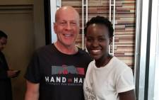 Lupita Nyong'o pictured with  Bruce Willis at the Hand in Hand: A Benefit for Hurricane Relief event. Picture: @Lupita_Nyongo