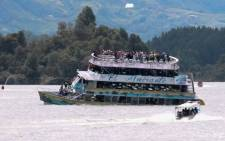 The tourist boat Almirante is seen in the Reservoir of Penol in Guatape municipality in Antioquia on June 25, 2017. At least nine people were dead and 28 missing after a tourist boat sank for unknown reasons in a reservoir in Colombia Sunday, authorities said, sharply raising an earlier toll. Picture: AFP.