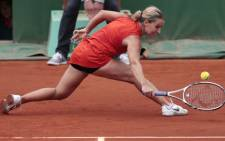Dominika Cibulkova hits a return to Victoria Azarenka during their Women's Singles 4th Round tennis match of the French Open tennis tournament at the Roland Garros stadium, on June 3, 2012. Picture: AFP