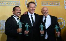 FILE: Actors Steven Michael Quezada, Bryan Cranston and Dean Norris, winners of the Screen Actors Guild award for outstanding performance by an ensemble in a drama series award for 'Breaking Bad' in 2014. Picture: AFP.