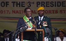 Newly sworn-in President Emmerson Mnangagwa speaks during the inauguration ceremony at the National Sport Stadium in Harare, on 24 November 2017. Picture: AFP