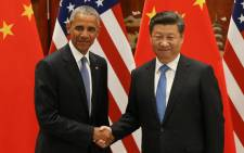 FILE: Former US President Barack Obama (L) and Chinese President Xi Jinping shake hands during a meeting at the West Lake State Guest House in Hangzhou on 3 September 2016, where the United States and China formally joined the Paris climate deal. Picture: AFP