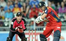 FILE: Highveld Lions batsman Dwaine Pretorius plays a shot as Sydney Sixers's captain Brad Haddin tries to make a catch on October 28, 2012 during the final Champions League T20 (CLT20) match at the Wanderers Stadium in Johannesburg. Picture: AFP
