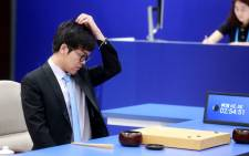 China's Go player Ke Jie reacts during the first match against Google's artificial intelligence program AlphaGo. Picture: AFP