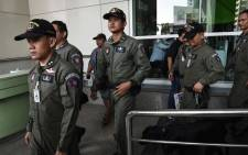 Members of a Thai police forensics unit leave the front entrance of Pra Mongkut Klao Hospital, which was struck by a small bomb, in Bangkok on 22 May 2017. Picture: AFP