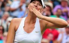 Maria Sharapova blows a kiss after powering into the Wimbledon 2011 finals on 30 June 2011. Picture: AFP