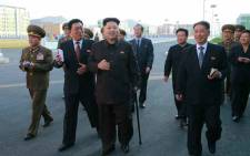 A photo released by the Rodong Sinmun, the newspaper of North Korea's ruling Workers Party, on 14 October 2014, shows North Korean leader Kim Jong-un walking with a cane during his visit to the Wisong Scientists Residential District in Pyongyang, North Korea, on 13 October 2014. This is Kim's first public appearance in 40 days. Picture: EPA.