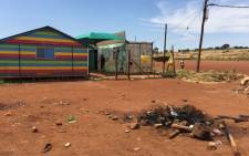 FILE: Rubble that is left following the murder of a woman accused of witchcraft and murder in Itireleng. Picture: Emily Corke/EWN.