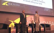 Sars Commissioner Tom Moyane (L) seen on stage with Finance Minister Malusi Gigaba (R) at the Tax Indaba in Sandton, on 11 September 2017. Picture: EWN.