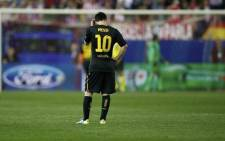 FC Barcelona's Lionel Messi looks dejected after his side's Champions League exit. Picture: AFP.