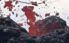 A lava fissure erupts in the aftermath of eruptions from the Kilauea volcano on Hawaii's Big Island, on 12 May, 2018 in Pahoa, Hawaii. Picture: AFP