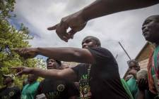 Amcu members outside the Brits magistrates court protest bail for the six murder accused appearing inside the court. Picture: Thomas Holder/EWN