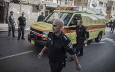 Israeli policemen escort an ambulance transporting Palestinian Nour Ab Hashye who allegedly stabbed an Israeli soldier after his arrest in Tel Aviv, Israel, 10 November 2014. Picture: EPA.