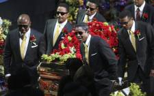 Pop singer Michael Jackson's casket is carried by family relatives after a service in his memory. Picture: AFP
