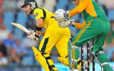 Australian captain Michael Clarke (L) plays a shot as wicketkeeper Mark Boucher looks on during the first One Day International at SuperSport Park in Centurion on 19 October 2011. Picture: AFP