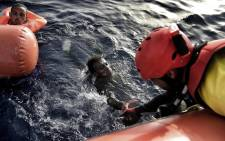 FILE: A migrant is rescued from the Mediterranean sea by a member of Proactiva Open Arms NGO north of Libya on 3 October 2016. Picture: AFP.