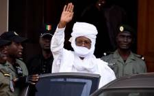 FILE: Former Chadian dictator Hissene Habre gestures as he leaves a Dakar courthouse after an identity hearing on 3 June 2015. Picture: AFP.