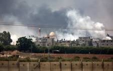 Smoke billowing from the coastal Palestinian enclave during shelling by the Israeli army on 22 July, 2014. Picture: AFP.