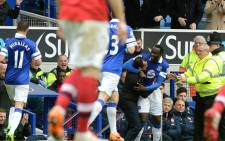 Everton's forward Romelu Lukaku celebrates with team manager, Roberto Martinez in their Premier League match against Arsenal at Goodison Park on 6 April 2014. Picture: Facebook.