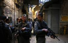 Israeli security forces stand guard at the site of a stabbing attack carried out by a Palestinian assailant in Jerusalem's Old City on 18 March 2018. Picture: AFP