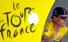 A picture taken on July 21, 2004 shows Yellow jersey US Lance Armstrong (US Postal/USA) concentrating before taking the start of the 16th stage of the 91st Tour de France cycling race, a time trial between Bourg d'Oisans and L'Alpe d'Huez. Picture: AFP.