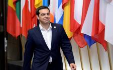 The Prime Minister of Greece Alexis Tsipras leaving at the end of a special EU Euro Summit about the Greek crisis held at the EU Council building in Brussels on 23 June 2015. Picture: AFP.